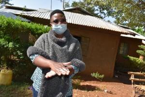 The Water Project: Shianda Community, Panyako Spring -  Trainer Jacky Demonstrates Handwashing