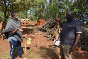 The Water Project: Shianda Community, Panyako Spring -  Demonstrating Alternative Contactless Greetings