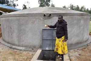 The Water Project: Wavoka Primary School -  Madam Waswa Celebrating The Complete Tank