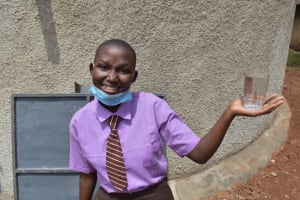 The Water Project: Friends Musiri Secondary School -  Brendah Holds A Cup Of Clean Water From The Tank