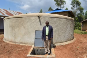 The Water Project: Friends Musiri Secondary School -  Principal Julius Kidambu At The Rain Tank