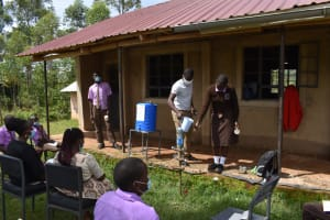 The Water Project: Friends Musiri Secondary School -  Wetting A Toothbrush During Dental Hygiene Session