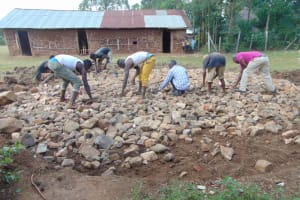 The Water Project: Mwikhupo Primary School -  Laying Stone Foundation