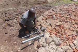 The Water Project: Mwikhupo Primary School -  Artisan Setting Score System