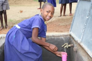 The Water Project: Mwikhupo Primary School -  Becky Collecting Water At The Tank
