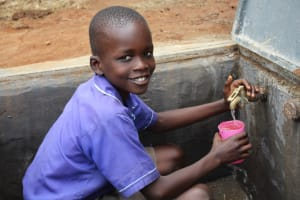 The Water Project: Mwikhupo Primary School -  Christopher Collecting Water At The Tank