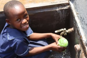 The Water Project: Mwikhupo Primary School -  Collecting Water At The Tank