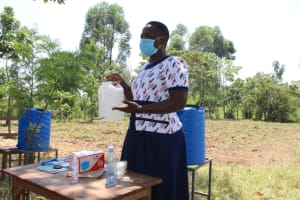 The Water Project: Mwikhupo Primary School -  Constructing Handwashing Leaky Tin