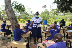 The Water Project: Mwikhupo Primary School -  Distributing Visual Aids At The Training