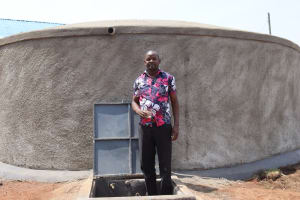 The Water Project: Mwikhupo Primary School -  Mr Nabangi At The Rain Tank