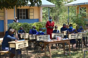 The Water Project: Mwikhupo Primary School -  Teacher Addresses Training Participants