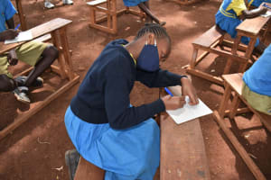 The Water Project: Kitagwa Primary School -  A Student Takes Notes At Training
