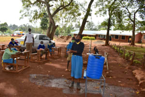 The Water Project: Kitagwa Primary School -  Gift Demonstrates Handwashing With Soap And Flowing Water