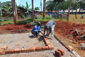 The Water Project: Kitagwa Primary School -  Laying Bricks For Latrine Wall Construction