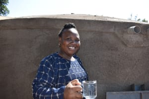 The Water Project: Kitagwa Primary School -  Madam Eunice Happy With Water From The Tank