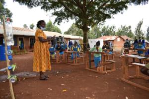 The Water Project: Kitagwa Primary School -  Madam Okumu Addressing Participants