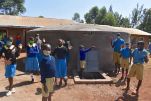 The Water Project: Kitagwa Primary School -  Students Posing At The Water Tank