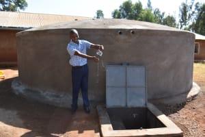 The Water Project: Kitagwa Primary School -  Teacher Luke Celebrates The Complete Tank