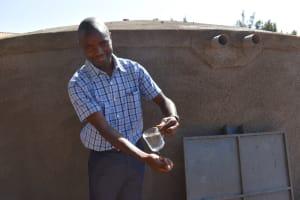 The Water Project: Kitagwa Primary School -  Teacher Luke Enjoying Water