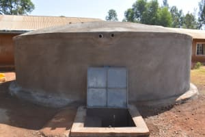 The Water Project: Kitagwa Primary School -  Water Flows From The Newly Completed Rain Tank