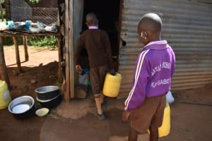 The Water Project: Bahati ADC Primary School -  Carrying Water Into The Kitchen