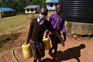 The Water Project: Bahati ADC Primary School -  Carrying Water To School