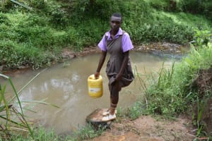 The Water Project: Bahati ADC Primary School -  Fetching Water At The Stream