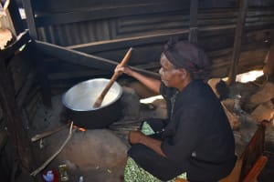 The Water Project: Bahati ADC Primary School -  School Cook At Work Inside The Kitchen