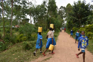 The Water Project: Itabalia Primary School -  Carrying Water