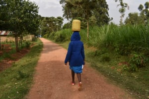 The Water Project: Itabalia Primary School -  Carrying Water From Home
