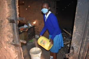 The Water Project: Itabalia Primary School -  Delivering Water For Storage In School Kitchen