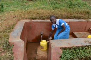 The Water Project: Itabalia Primary School -  Sarah Fetching Water At The Spring