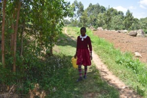 The Water Project: Gimariani Primary School -  Carrying Water