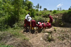 The Water Project: Gimariani Primary School -  Collecting Water