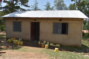 The Water Project: Gimariani Primary School -  Kitchen With Water Containers Out Front