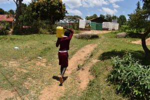 The Water Project: Gimariani Primary School -  Student Carrying Water To School From Home