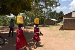 The Water Project: Gimariani Primary School -  Students Carrying Water To School
