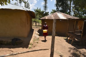 The Water Project: Gimariani Primary School -  Students Going To Fetch Water From Home