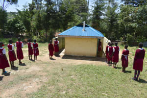 The Water Project: Gimariani Primary School -  Girls Line Up To Use The Latrines
