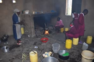 The Water Project: Gimariani Primary School -  Students Help The School Cook Prepare Food In The Kitchen