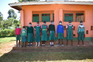 The Water Project: Itieng'ere Primary School -  Girls Outside Their Latrines
