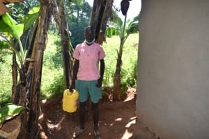 The Water Project: Itieng'ere Primary School -  Moses Carrying Water