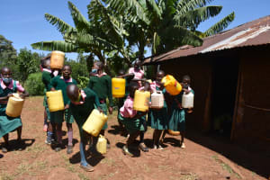 The Water Project: Itieng'ere Primary School -  Students Unloading Their Water At School