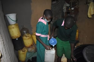 The Water Project: Itieng'ere Primary School -  Children Collecting Water From A Nearby Home