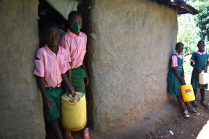 The Water Project: Itieng'ere Primary School -  Pupils Leave Home With Water