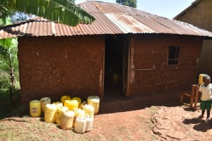 The Water Project: Itieng'ere Primary School -  Water Containers Outside The Kitchen