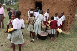 The Water Project: Muriola Primary School -  Pouring Water Into Pots