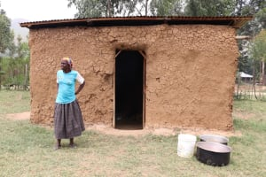 The Water Project: Muriola Primary School -  School Chef Mary In Front Of The Kitchen