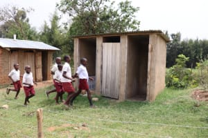 The Water Project: Muriola Primary School -  Boys Rushing To Their Latrines
