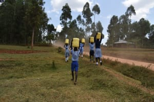 The Water Project: Ebukuya Special School for the Deaf -  Carrying Water Along The Road